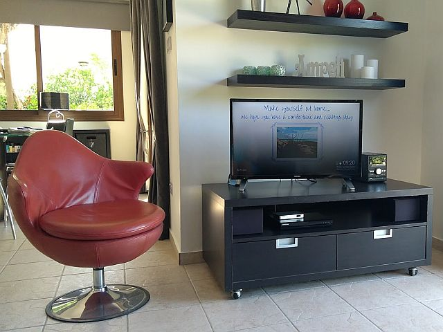 The TV with DVD player and CD MP3 music player at Ampeli Villa