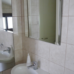 Downstairs loo with full-length mirror