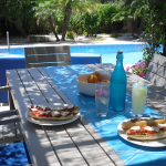 Lunch under dappled pergola shade