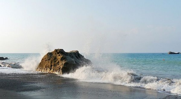 Waves splashing on Black Rock at Pissouri beach